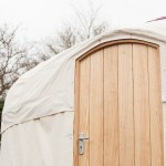 The distinctive rounded door top of a Yurts For Life yurt