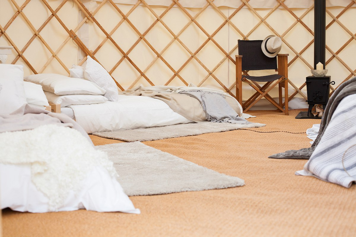 Style your yurt interior with futon beds and a wood-burning stove