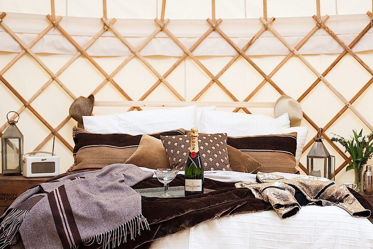 Luxury yurt interior styled with chamapgne