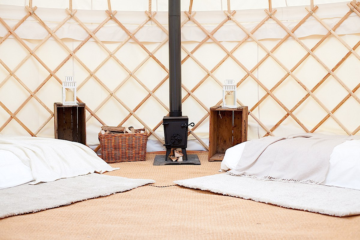 Style your yurt interior with futons and a wood burner